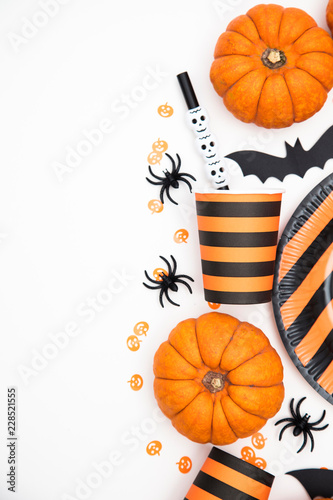 Halloween party background with pumpkins, spooky bats, creepy spiders