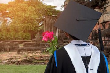 Back portrait of female graduates wearing black hat