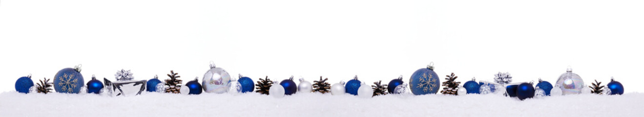 Blue christmas balls with xmas present gift boxes in a row isolated on snow, Christmas banner