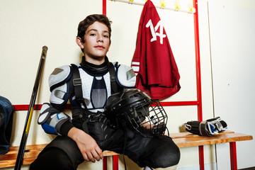Hockey player preparing for game in locker room