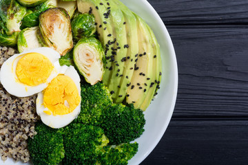 Buddha bowl with quinoa , eggs , avocado , brussels sprouts and broccoli