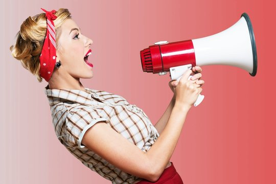 1950s style housewife yelling into a megaphone - isolated image