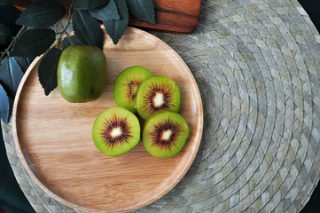 Top view of Red Kiwifruit on Wooden Plate
