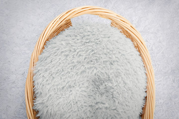 Wicker basket with blue fur and blue blanket