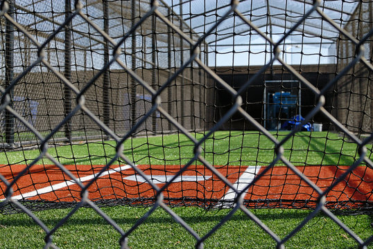 Home plate of a batting practice cage.