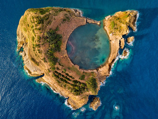 Top view of Islet of Vila Franca do Campo is formed by the crater of an old underwater volcano near San Miguel island, Azores, Portugal. Bird eye view, aerial panoramic view.