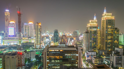 Beautiful cityscape of office building in the night at Bangkok , Thailand.