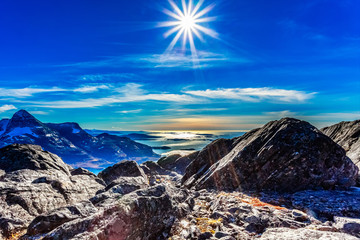 Polar arctic greenlandic  sun in its zenith over the fjord and m