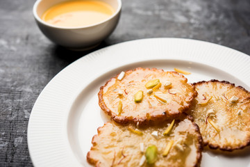 Malpua sweet - Traditional Indian dessert or pancake for festivals, served in plate with rabri/rabdi . selective focus