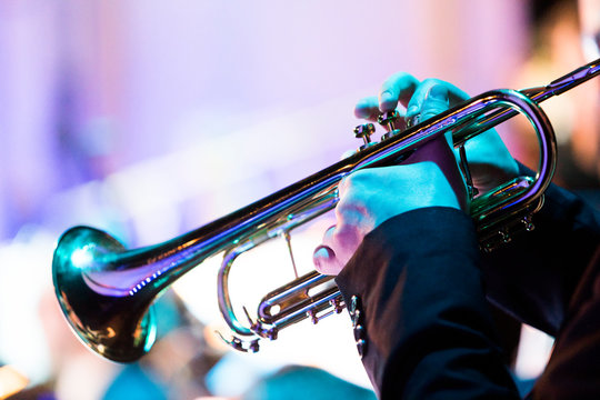 A person playing a trumpet during a concert