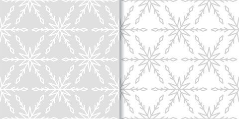Snowflakes. Seamless patterns. Gray and white winter ornaments
