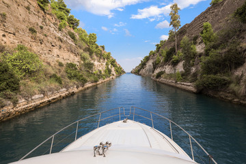 Passing through the Corinth Canal on a yacht from the Saronic Gulf, Aegean Sea to the Corinth Gulf, Ionian Sea.