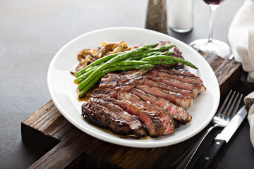 Garden Poster Steakhouse Beef steak with asparagus and mushrooms