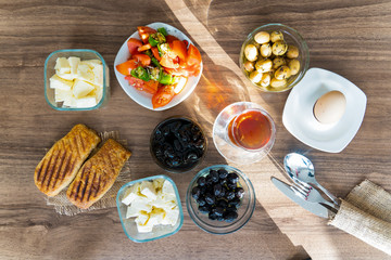 Breakfast with tea on wooden table