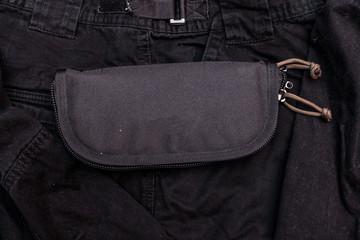 Nylon wallet. Tactical organizer. Black wallet on a black background.