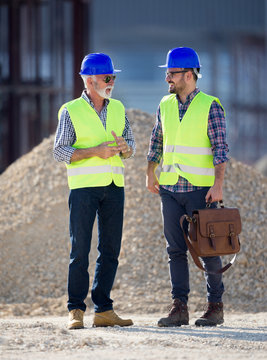Engineers talking at building site