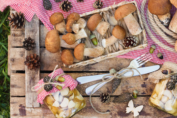 White mushrooms, pine cones and decorations on the wooden table