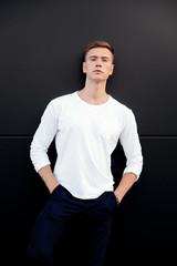 Male model, man on the black background, handsome man