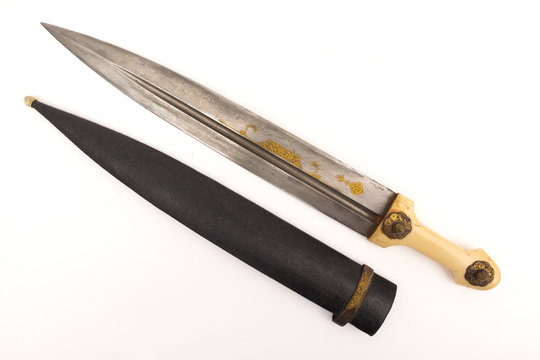 Oriental dagger with a handle from a bone sheath on a white background.