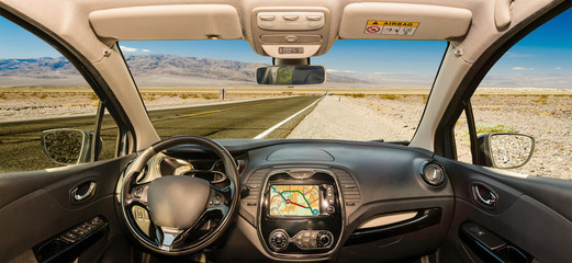 Car windshield with view of desert road, Death Valley, USA
