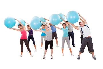Fitness class exercising in a gym
