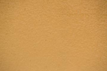 creamy, dark yellow wall texture background