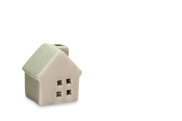 Clipping path included, miniature grey ceramic house isolated on white with copy space.