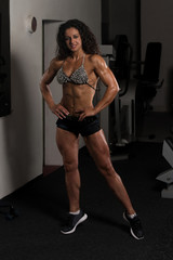 Healthy Young Woman Flexing Muscles