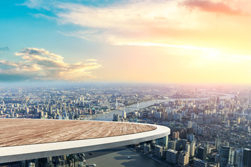 Panoramic Shanghai skyline and buildings with empty wooden square floor platform Wall mural