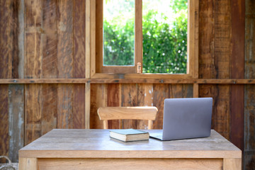 Workspace with laptop on wood desk table.