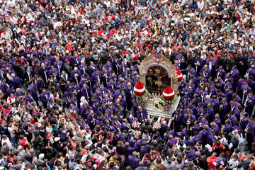 Faithful attend the procession of Senor de Los Milagros ( Lord of Miracles ), Peru's most revered Catholic religious icon, in Lima