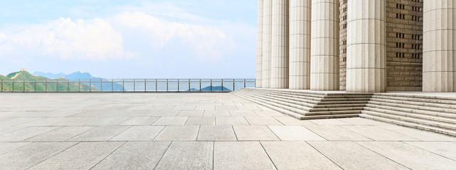 Empty square floor and modern architecture with mountain natural scenery