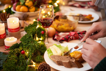 Guest eating delicious dishes at Christmas dinner
