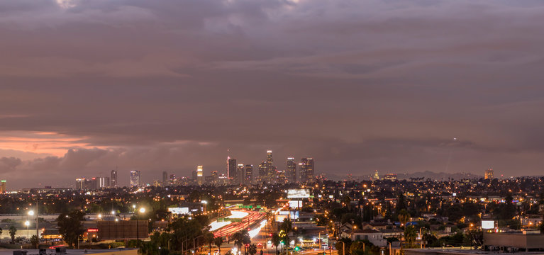 Sunset over Downtown Los Angeles and East LA on a stormy autumn evening, California, USA.