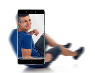 Portrait of happy smiling athletic healthy young man. conceptual image with a smartphone, demonstration of device capabilities