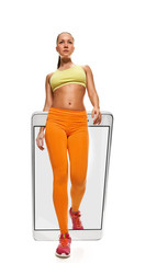 Young fit healthy woman in sportswear running slow, concept virtual reality of the smartphone. going out of the device