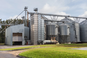 Exterior of Agricultural Silo building with storage tanks for agricultural crops processing plant, drying of grains, rape, wheat, corn, soy, sunflower.