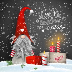 Christmas dwarf with candles and gift boxes on black background