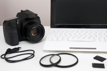 camera, photography equipment and computer on the table