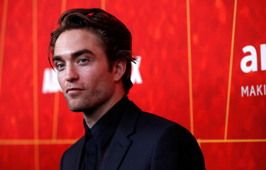 Actor Pattinson poses at the ninth amfAR Gala Los Angeles in Beverly Hills