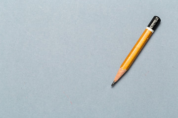 Still life of short worn down  pencil on light gray background