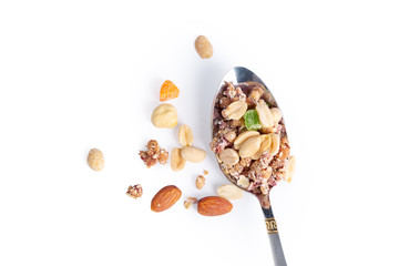 Photo of Full spoon of granola isolated on white background