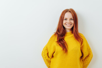 Happy smiling young redhead woman