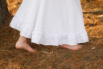 feet and white dress
