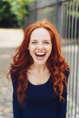 Pretty vivacious woman enjoying a good laugh