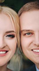 Beautiful newlyweds are smiling close up. Wedding idea. Wedding faces. Wedding photography. Half face.