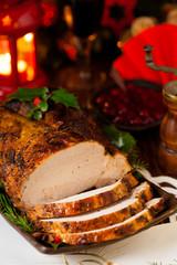 Roast pork loin with Christmas decoration.