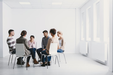 Group psychotherapy in white interior