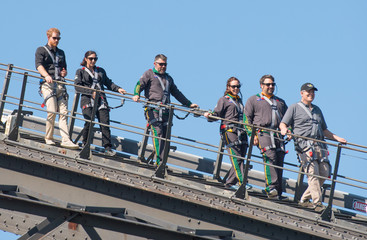 Britain's Prince Harry descends the Sydney Harbour Bridge in Sydney