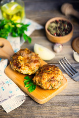 pork cutlets with greens on a wooden board